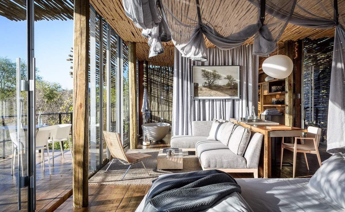 Schlafzimmer einer Suite in Singita Krüger