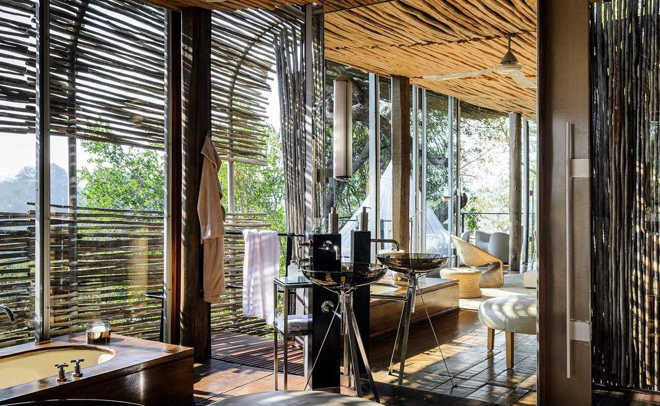 Badezimmer einer Suite in Leombo