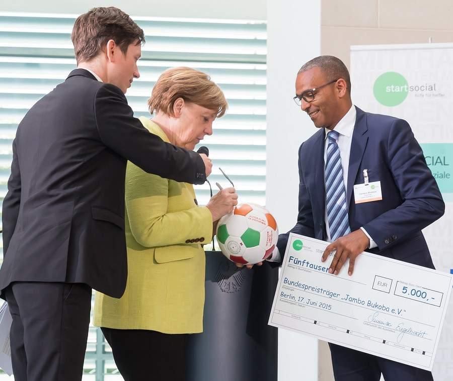 Clemens Mulokozi und Angela Merkel